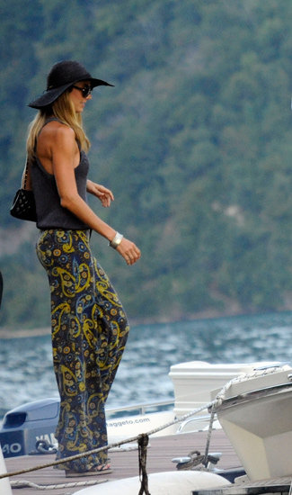On holiday with her man, George (Clooney, if you've been hiding under a rock), Stacy Keibler's look is a lesson in how to do resort wear — the paisley-print wide-leg pants are reminiscent of '70s glamour, and the simple tank balances them. Add a floppy hat, and she may as well be setting sail on an Italian lake with one the sexiest man in the world — oh, wait . . .