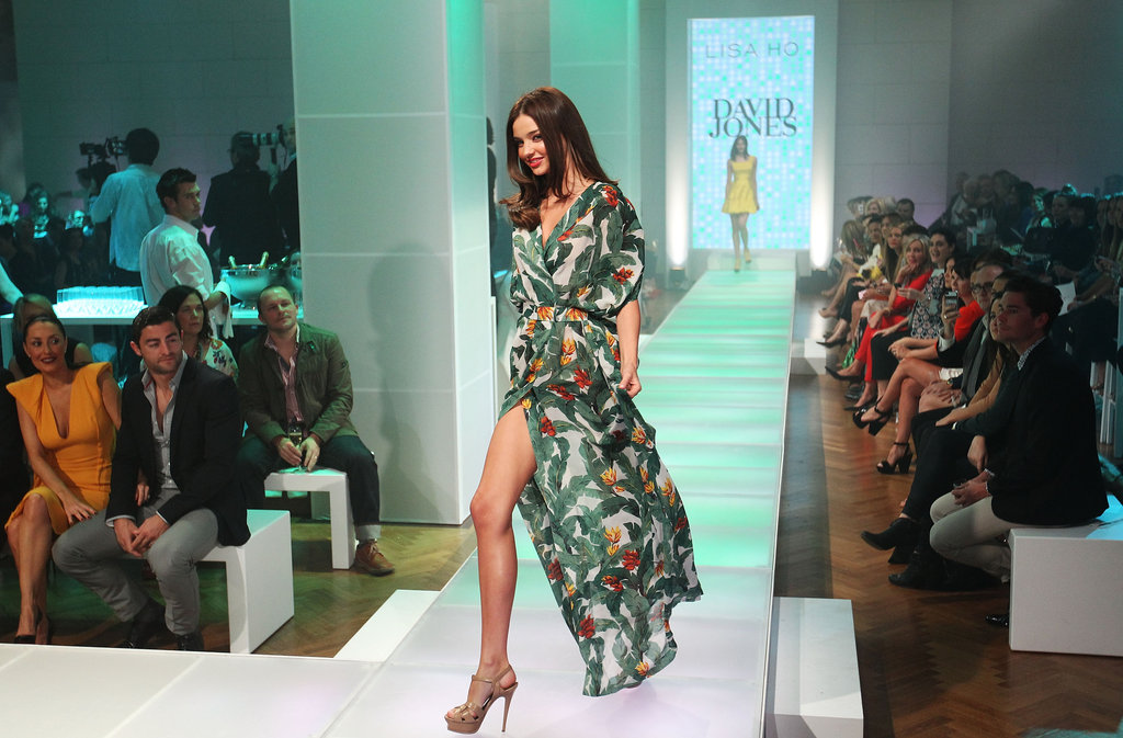 Miranda Kerr sported a green dress on the runway.
