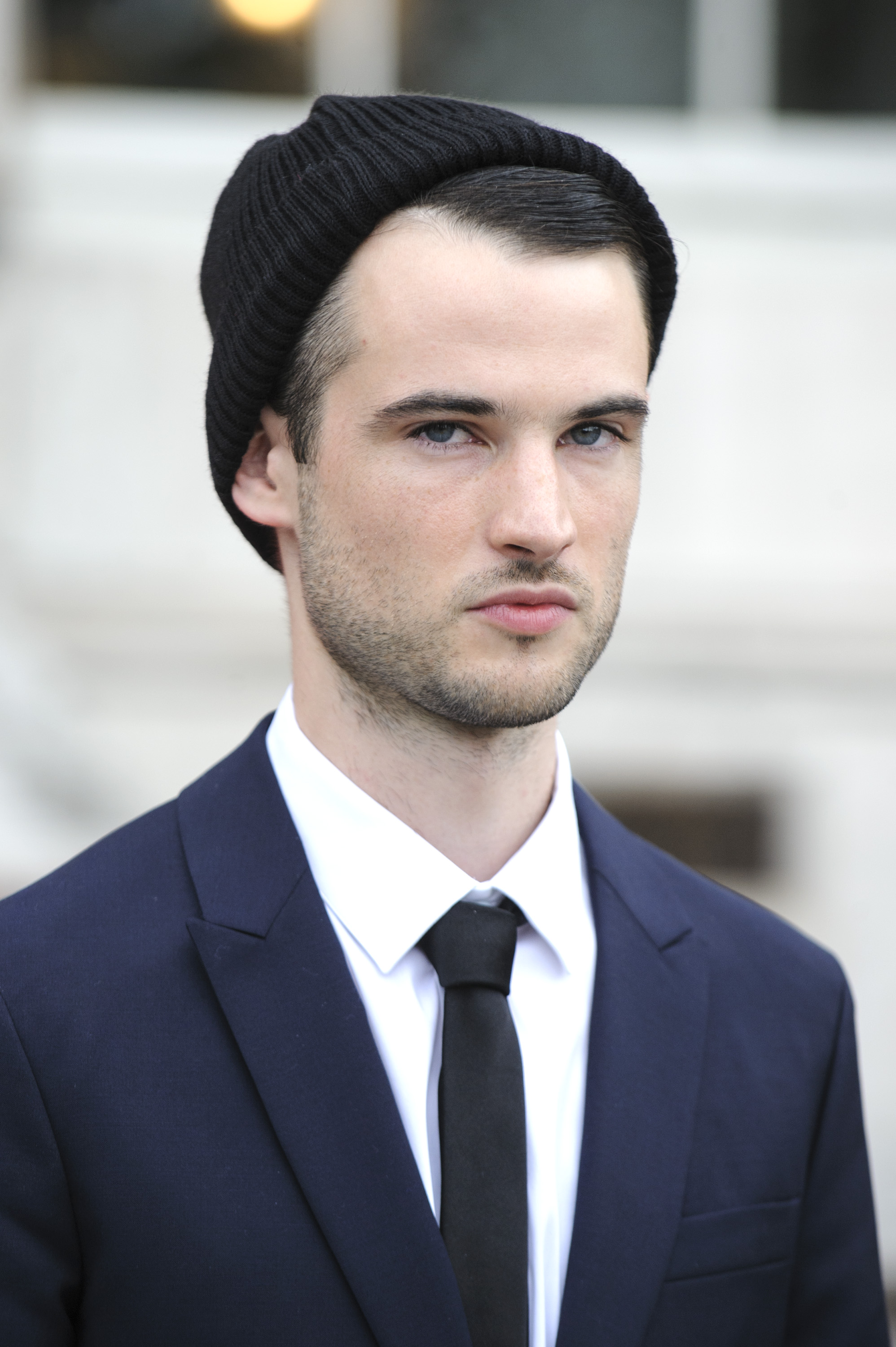 Tom Sturridge wore a beanie hat.