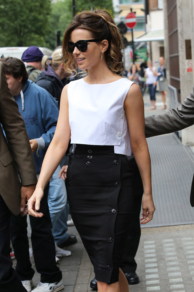 The structural cut and utilitarian button details offer up an even crisper feel to this black and white look.