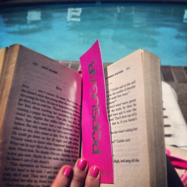 "Lounging poolside, gracehitchcock kept her place with a POPSUGAR bookmark and ""pop pink manicure."""