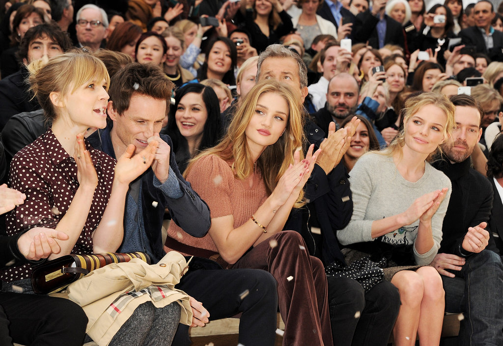 Clémence Poésy, Eddie Redmayne, Rosie Huntington-Whiteley, Mario Testino, Kate Bosworth and Michael Polish cosied up during the London Burberry show in February 2012.