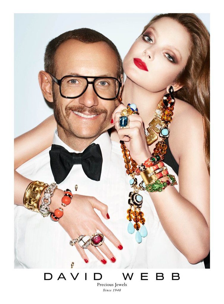 Decadent costume jewelry brighten up this David Webb ad.