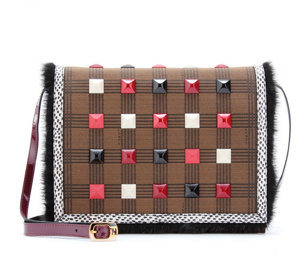 """I'm a sucker for novelty clutches, so you can imagine my excitement when I came across this magnificent Fendi Daisy clutch. The multicolored studs, fur trim, and patent detailing look one-of-a-kind, and the smart optional strap is ideal for when you want to go hands-free."" — Chi Diem Chau, associate editor Fendi Daisy Clutch ($1,551)"