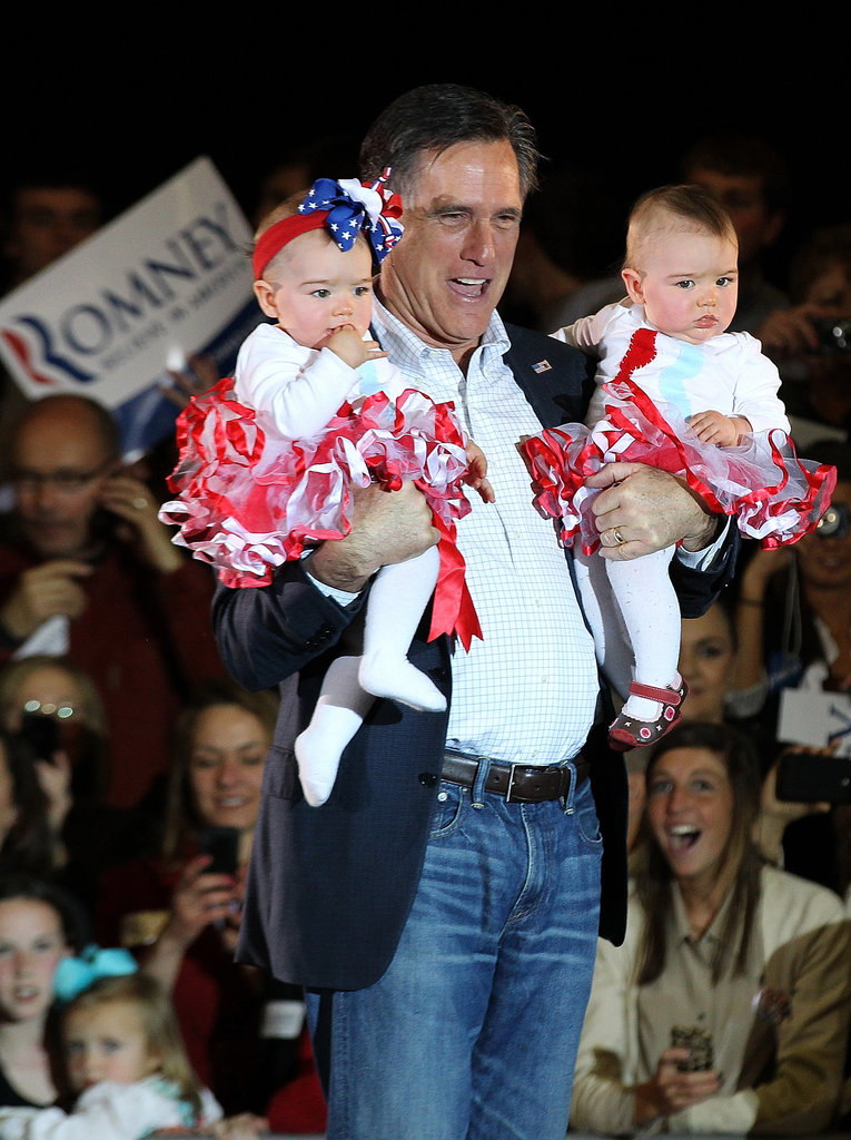 Mitt Romney held two babies during a Super Tuesday rally at an elementary school in Knoxville, TN, in March.