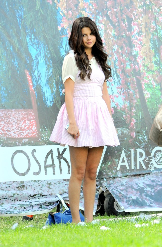Selena Gomez stood in front of a backdrop.