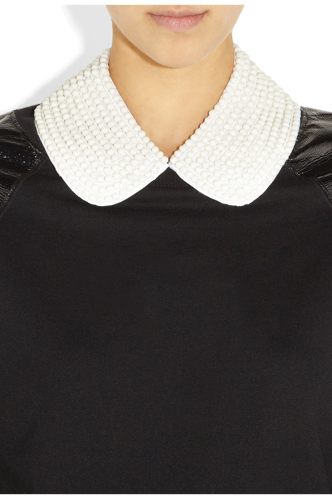 This gorgeous collar will add a touch of ladylike polish to our sweaters and even t-shirts — and it's a cinch to throw on.  Karl Abbey Faux Pearl Collar ($115)