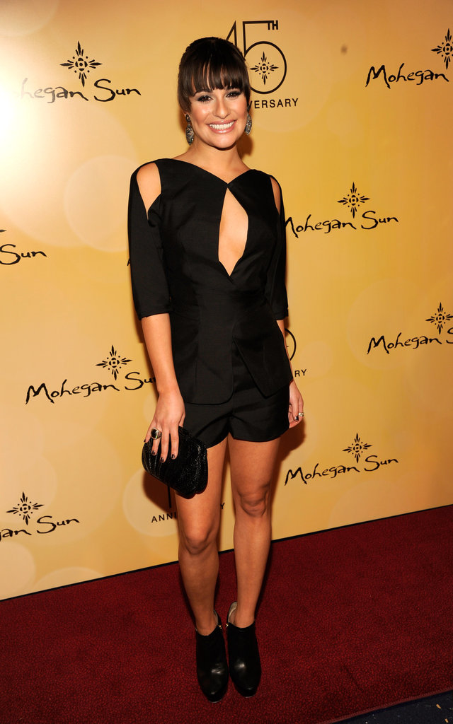 Lea wore a Luca Luca black wrap tulip vest with black short shorts for an event in 2011.