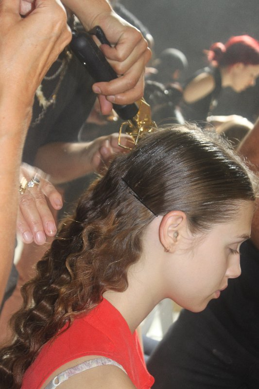 Lead hairstylist Odile Gilbert used a three-barreled iron to create romantic crimped waves in the back. A modern middle part was gelled and Kérastase Paris Elixir Ultime The Imperial provided an extreme shine.