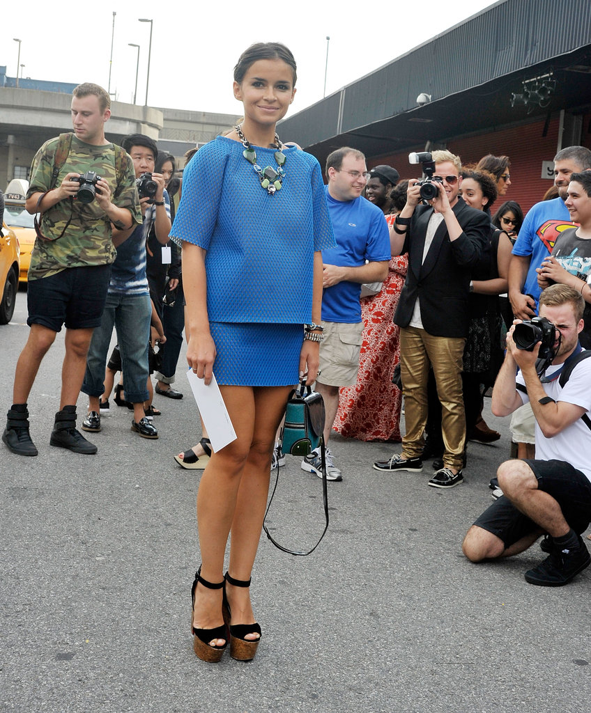 Miroslava Duma emboldened a blue skirt set with major platforms and statement jewels.