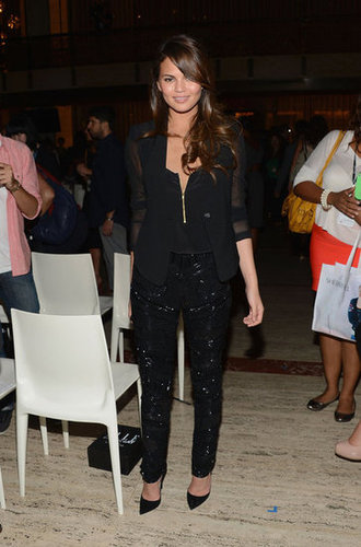 Chrissy Teigen took a slick all-black stance on her front-row styling, as showcased at the Elle Fashion Next show.