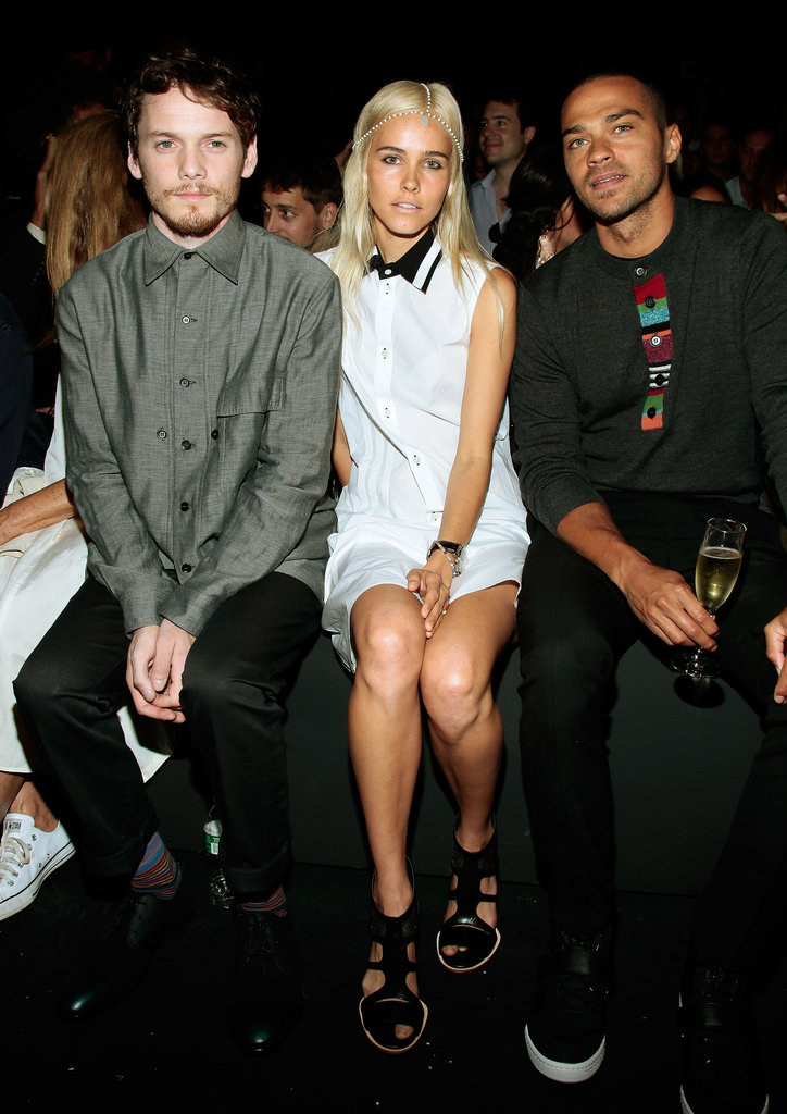 Isabel Lucas paired flat gladiator sandals with a black-collared white dress at the Y-3 show.