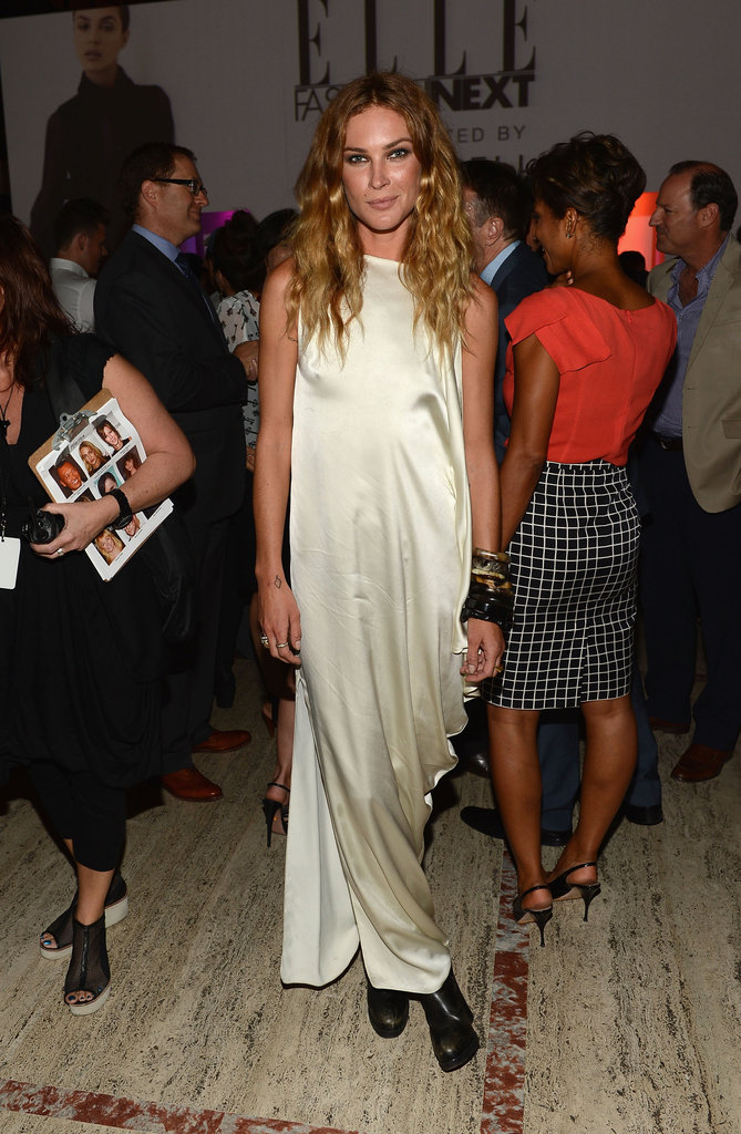 Erin Wasson paired black ankle boots with a silky floor-length dress at the Elle Fashion Next show.