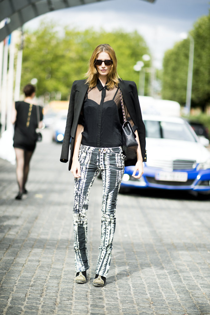 Printed pants are way cooler than your average denim — the proof is right here. Just add in sleek black or neutral pieces to balance the statement power. Source: Adam Katz Sinding