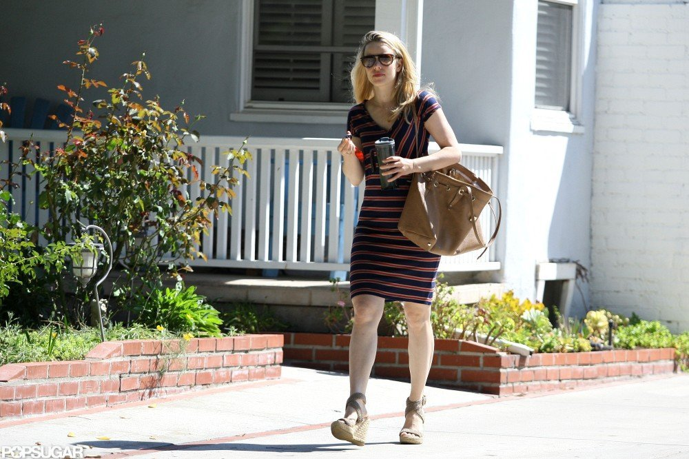 Rachel McAdams carried a brown handbag while wearing a striped dress in LA.
