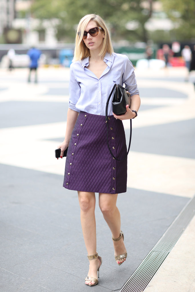 A borrowed-from-the-boys button-down meets a ladylike skirt. Source: Greg Kessler