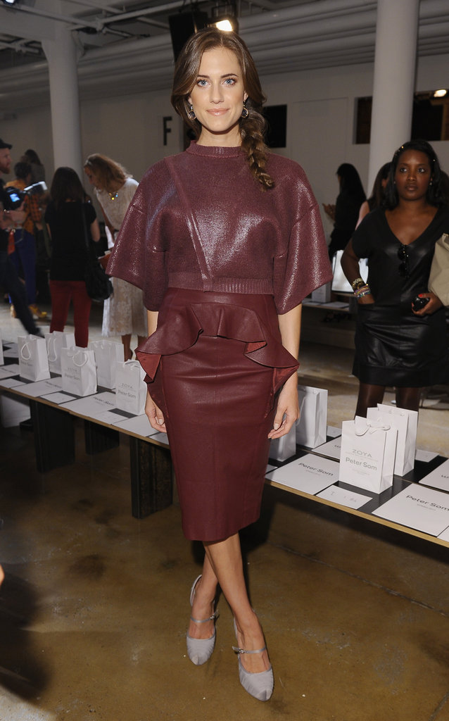 Allison Williams showed off this season's hottest hue — on a peplum-trimmed leather skirt, no less — front row at Peter Som.
