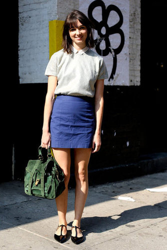 Rich jewel tones on her skirt and bag gave this look a chic color story.