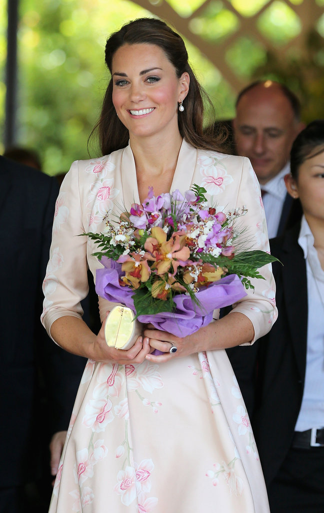 Kate Middleton was presented with flowers at a botanical garden in Singapore.