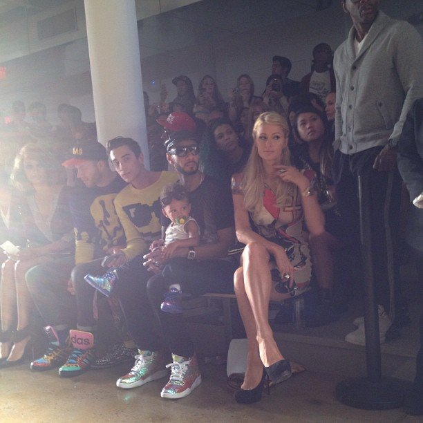 Paris Hilton took a front row seat next to Tyra Banks and Swizz Beatz who had Egypt on his lap for Jeremy Scott's show. Source: Instagram user nylonmag