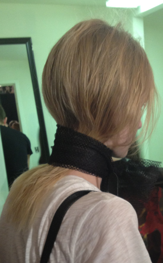 To achieve this, he first sprayed the hair with Fekkai Luscious Curls Spray ($25) and diffuse-dried it. He then pulled the bottom layer of hair into a tight ponytail, sprayed it with hair spray, dried it in, and then cut the elastic out. Next, he released the top layer of hair, doused it with water, pressed it down, and held it in place by tying a mesh scarf around the models' necks. Right before the models walked out, he pulled the scarves off and sent them down the runway.