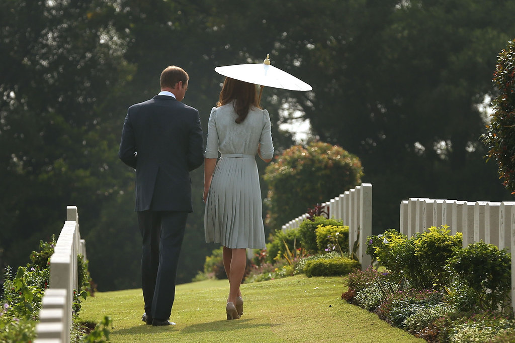 Kate Middleton had an umbrella to cover her from the son as she visited the Kranji War Memorial with Prince William.