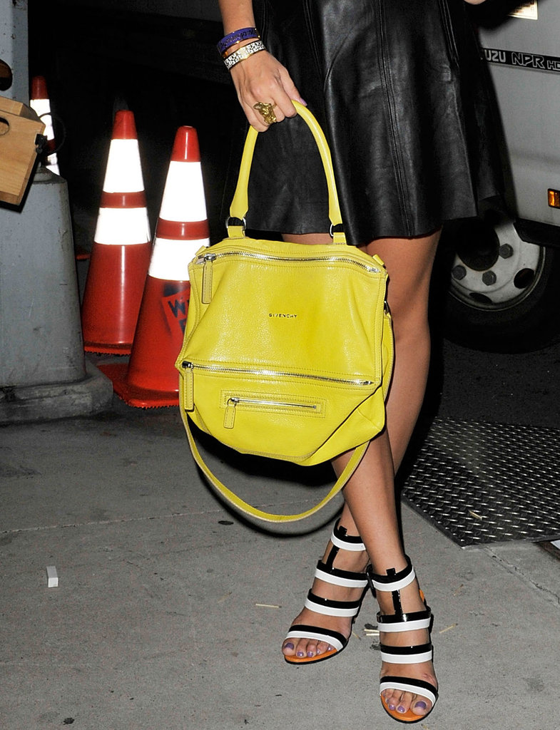 This lemon-hued Givenchy satchel looked especially cool against black and white Bottega Veneta heels.