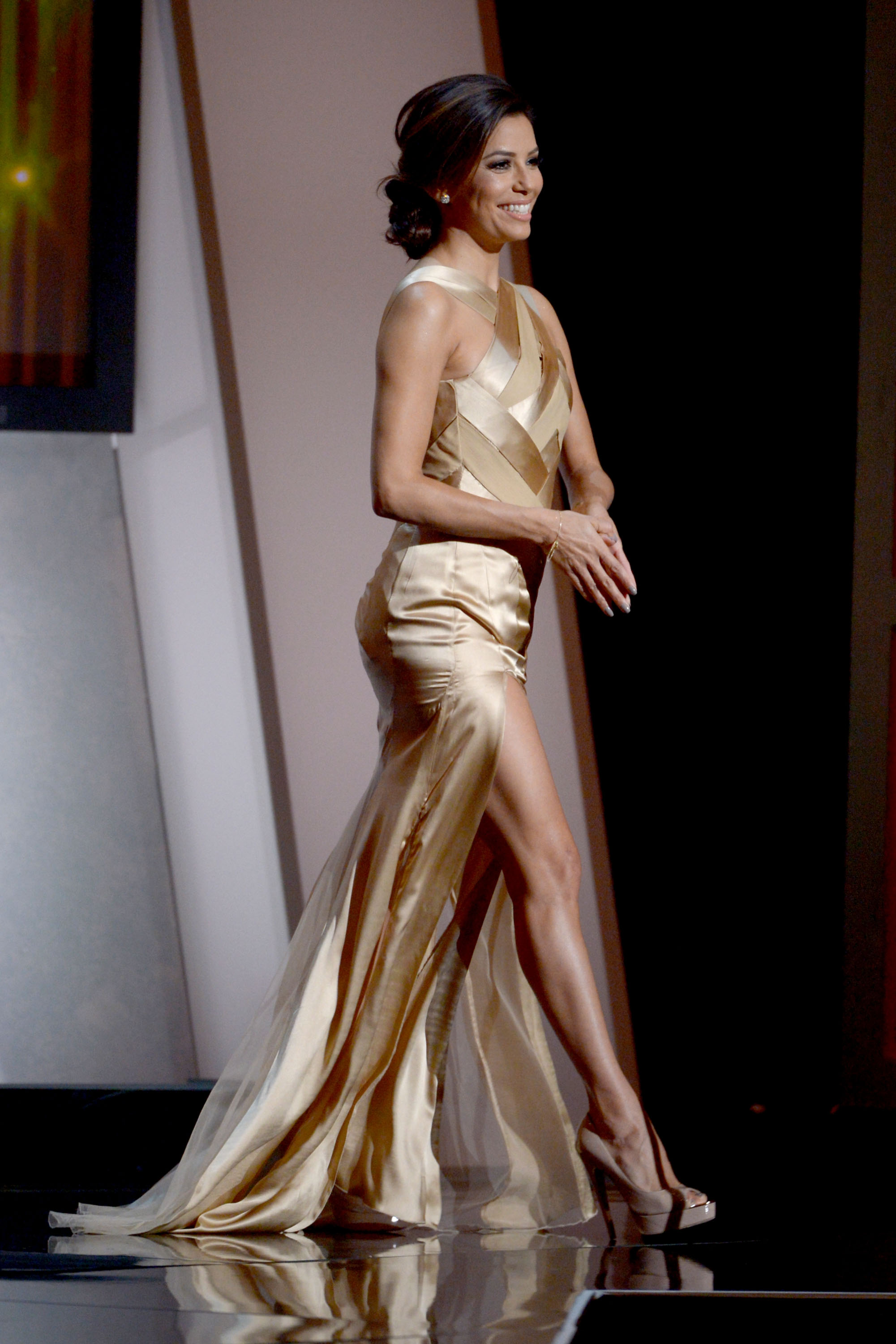 Eva Longoria changed into a champagne-colored gown at the ALMA Awards in LA.