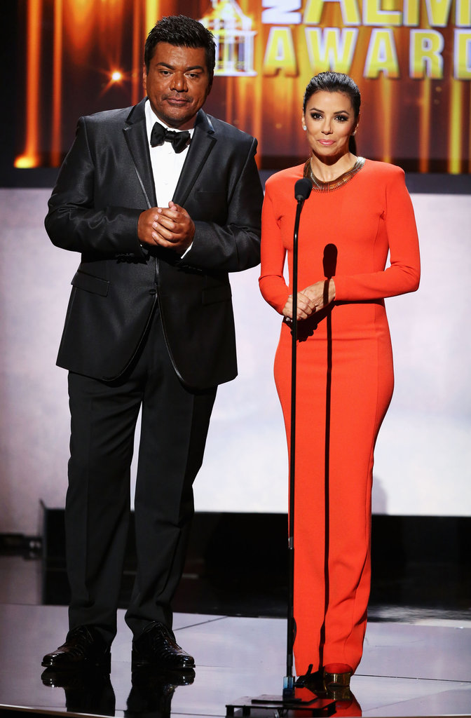 Eva Longoria wore a bright orange gown to take the stage with George