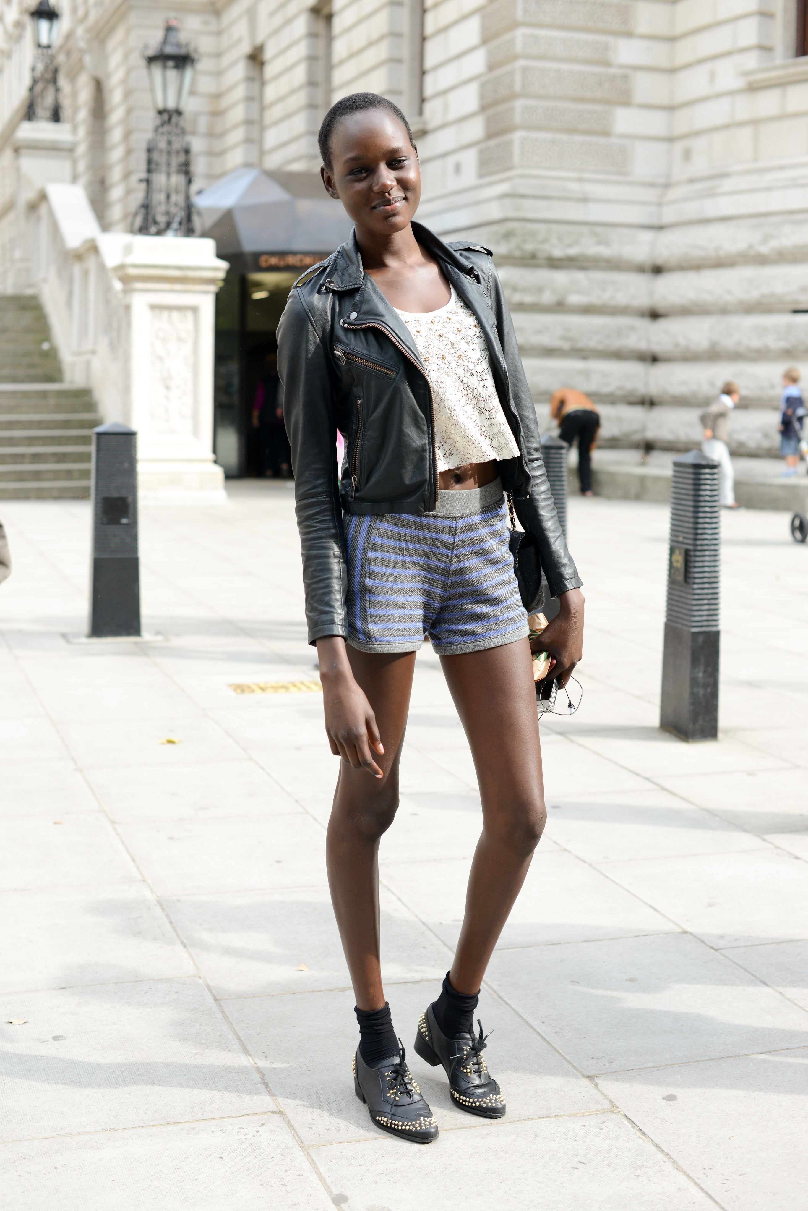 Punch up sportier shorts with a slick leather jacket.