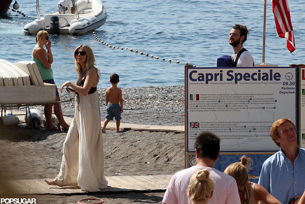 Sienna Miller walked along the beach in Positano.