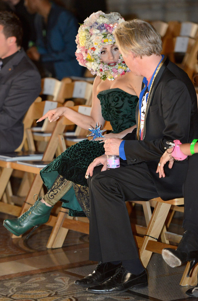 Lady Gaga talked with hat designer Philip Treacy.
