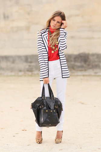 Stripes offset the bold poppy-reds and white in her streamlined look.