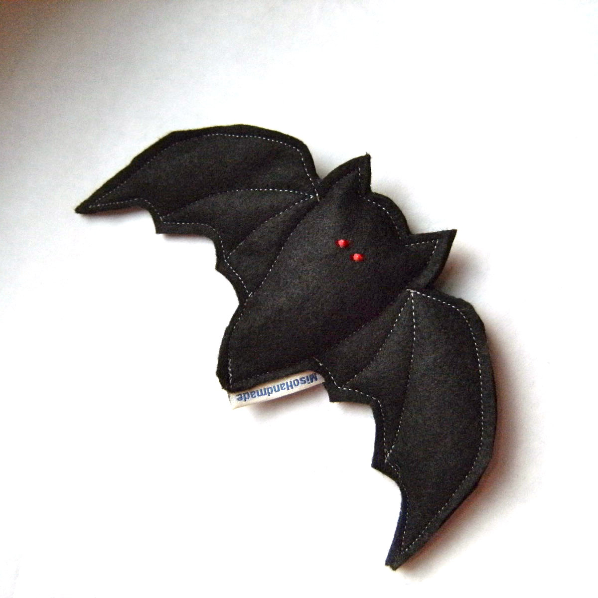 Tricks with no treats isn't a fair shake. Cats will go batty for a catnip-filled Scaredy Bat toy ($8), and they may even forgive you for sneaking up on them in that zombie mask.