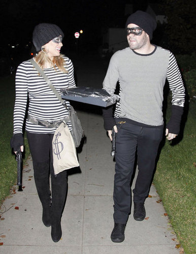 Hilary Duff and Mike Comrie matched as burglars while out in LA in 2011.