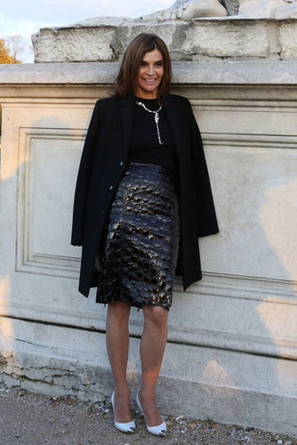 Carine Roitfeld worked bold texture into her slick all-black ensemble, then countered with a pop of white on her heels.