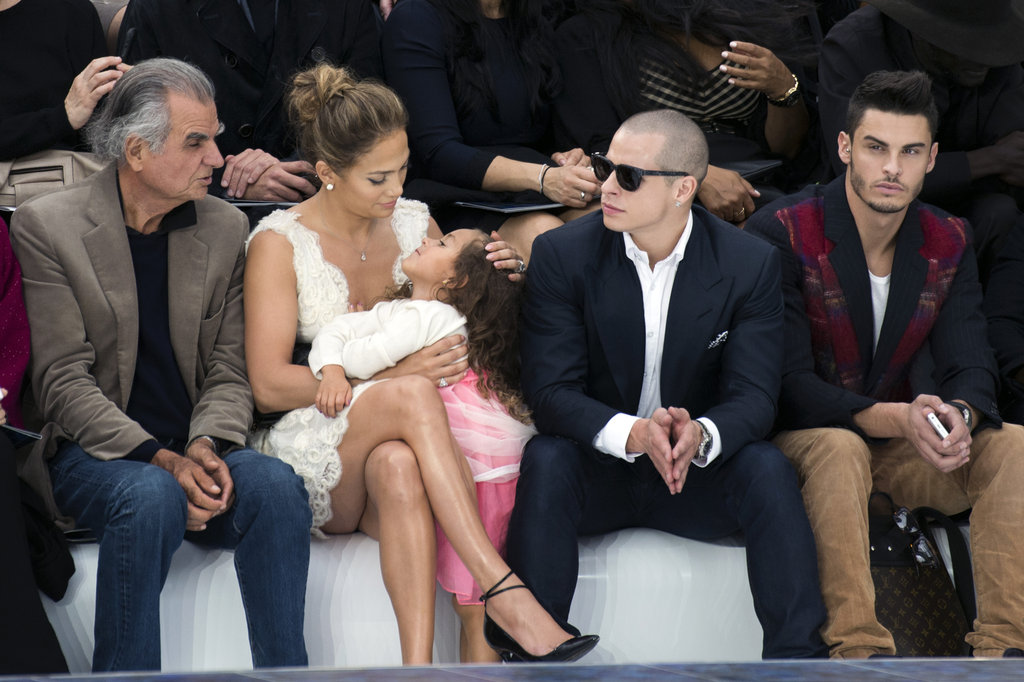 Jennifer Lopez sat next to Casper Smart with Emme Anthony on her lap at the Chanel show.