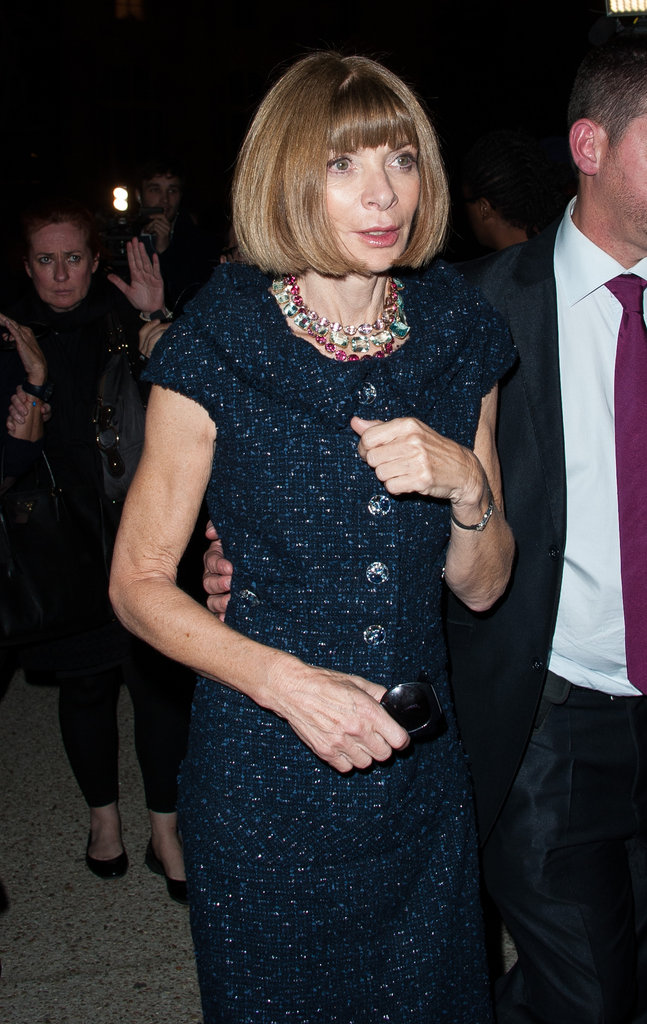 Anna Wintour wore an ultra ladylike skirt suit in a regal navy-blue tweed to Saint Laurent.