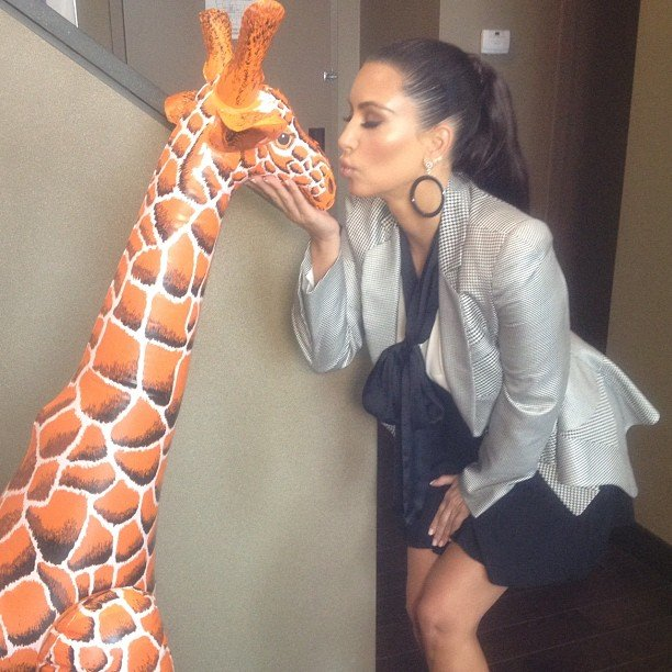 Kim Kardashian made friends with a plastic giraffe.  Source: Instagram user kimkardashian