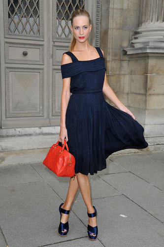 Poppy Delevingne looked ultrachic at the Louis Vuitton show in a navy-blue off-the-shoulder dress with matching blue sandals. Her bright orange-red bag made the ensemble pop.