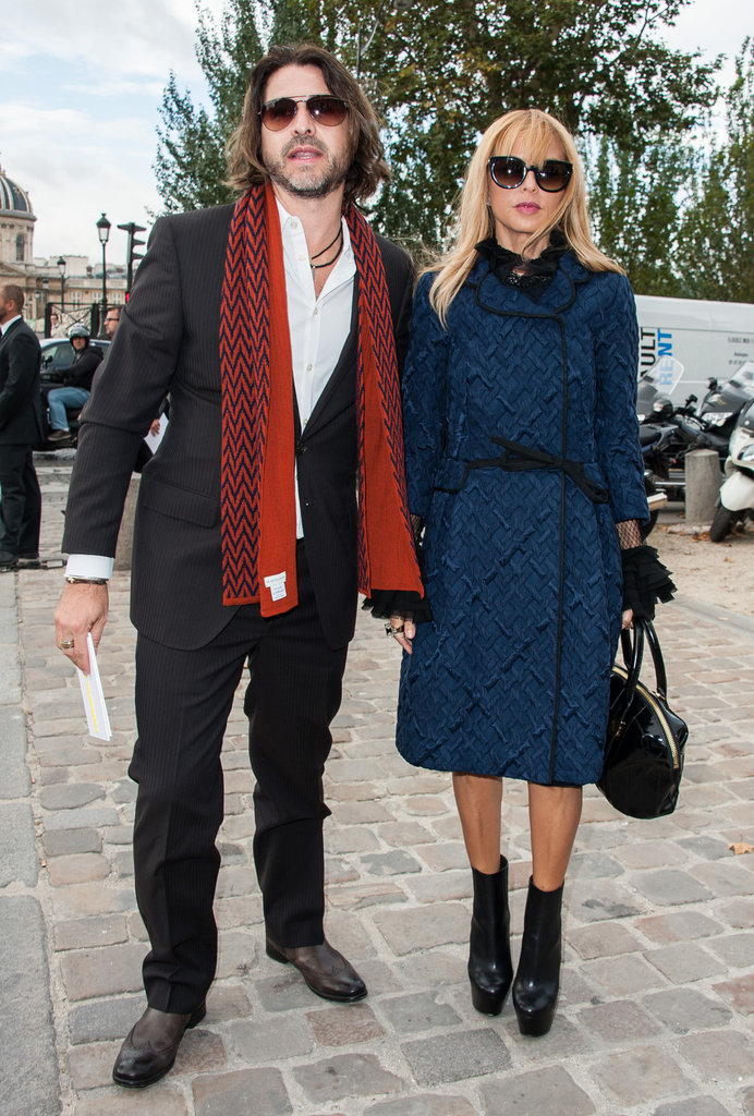 Rachel Zoe covered up outside the Louis Vuitton show in a texturized navy-blue overcoat and chunky platform booties.