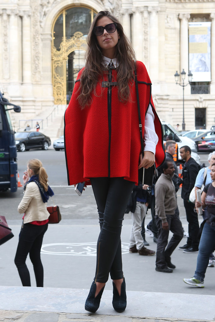 A red cape is one way to break up a basic look with a gorgeous, color-rich effect.