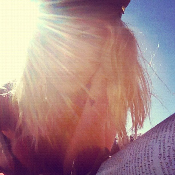 Lara Bingle took advantage of the sunshine and a good book. Source: Instagram user mslbingle