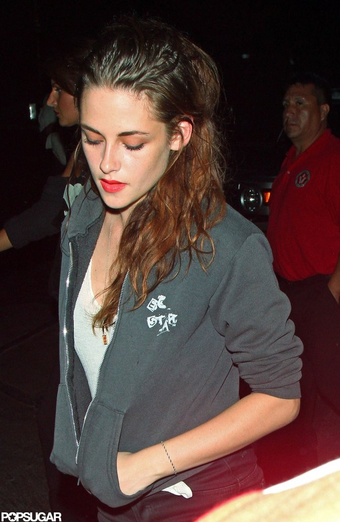 Kristen Stewart attended a Florence and the Machine concert wearing a zip-up hooded sweatshirt.