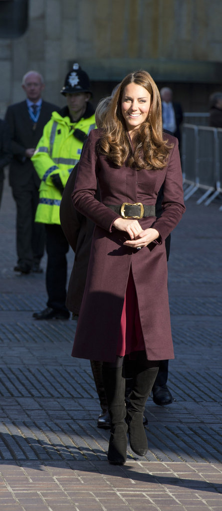 Kate Middleton wore a burgundy coat and black boots to tour the Newcastle Civic Centre.