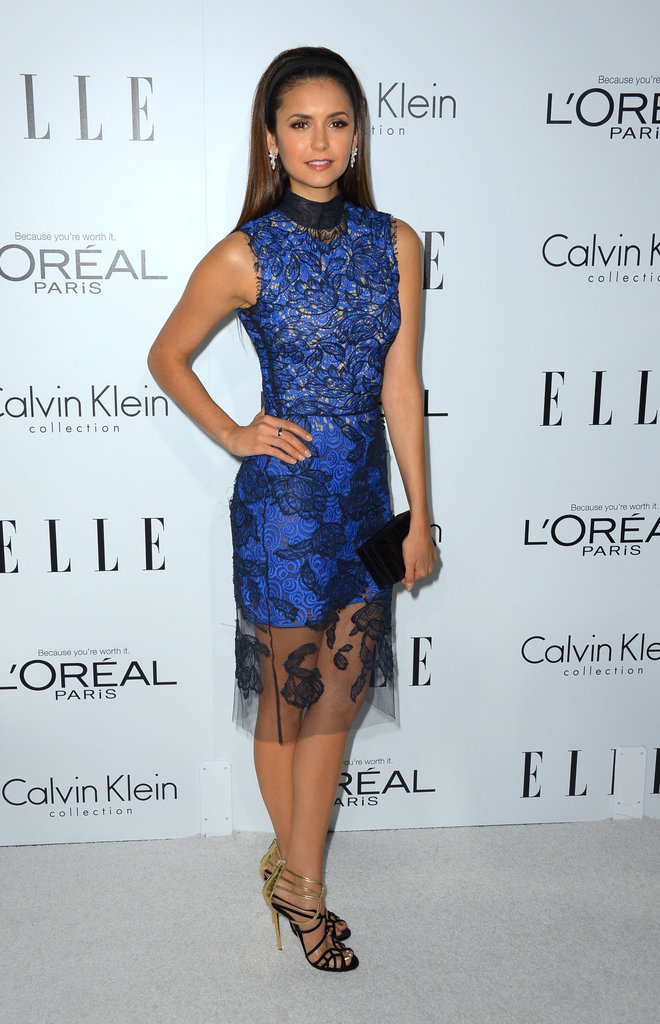 Nina Dobrev looked to a more dramatic blue-and-black lace sheath with strappy metallic heels and megawatt jeweled earrings to complement her ultrafeminine style.
