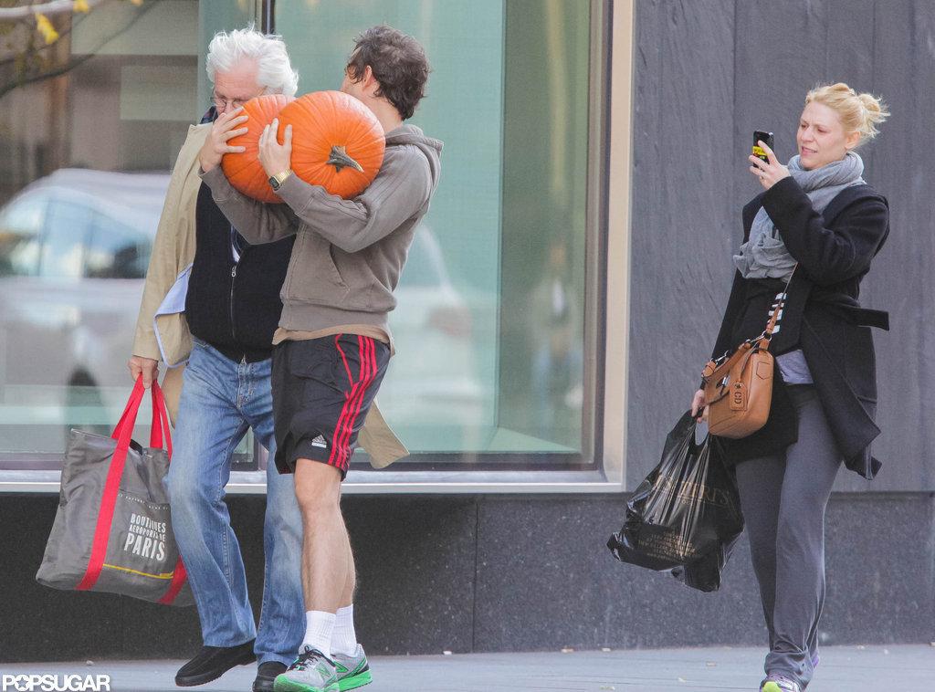 Claire Danes captured a photo of Hugh Dancy carrying pumpkins in Toronto.