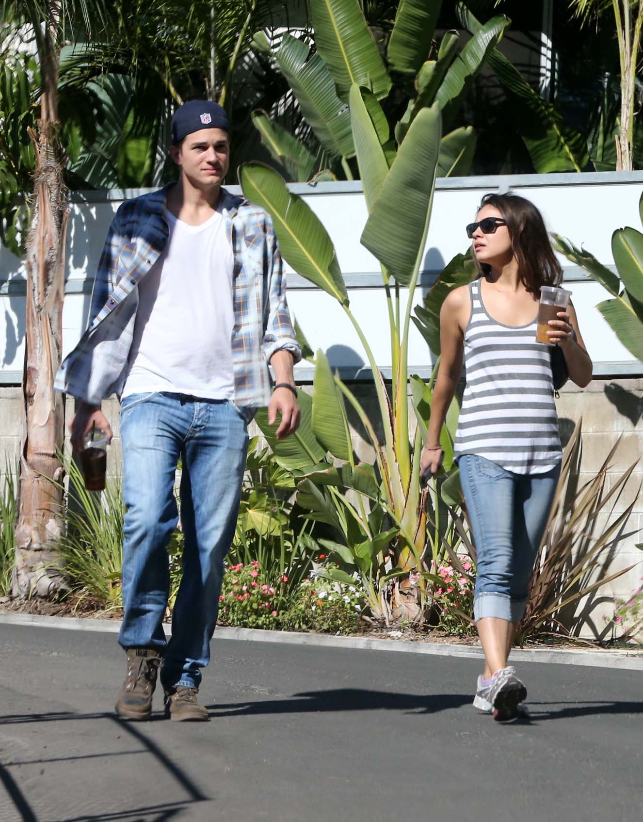 Ashton Kutcher and Mila Kunis left a friend's house together in LA.