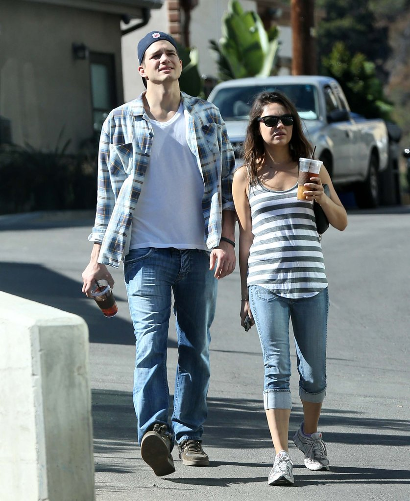 Ashton Kutcher and Mila Kunis carried drinks while out for a walk together.