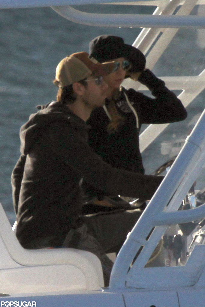 Enrique Iglesias and Anna Kournikova sat side by side on the boat.